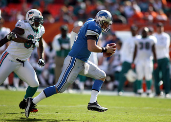 MIAMI - DECEMBER 26:  Quarterback Shaun Hill #14 of the Detroit Lions scrambles against the Miami Dolphins at Sun Life Stadium on December 26, 2010 in Miami, Florida.  (Photo by Marc Serota/Getty Images)