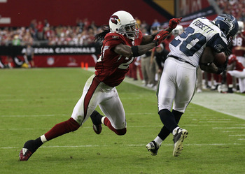 GLENDALE, AZ - NOVEMBER 14:   Cornerback Greg Toler #28 of the Arizona Cardinals knocks down running back Justin Forsett #20 of the Seattle Seahawks after a pass reception at University of Phoenix Stadium on November 14, 2010 in Glendale, Arizona. Seattle