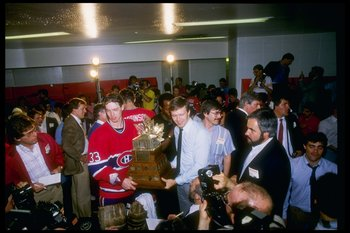24 May 1986:  Goaltender Patrick Roy of the Montreal Canadiens holds the Conn Smythe Trophy after the Canadiens defeated the Calgary Flames to win the series 4-1 at the Olympic Saddledome in Calgary, Canada.  The Canadiens won the game 4-3. Mandatory Cred
