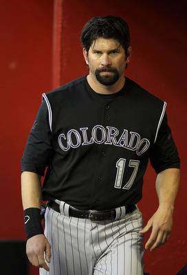 PHOENIX, AZ - MAY 03:  Todd Helton #17 of the Colorado Rockies walks in the dugout during the Major League Baseball game against the Arizona Diamondbacks at Chase Field on May 3, 2011 in Phoenix, Arizona.  (Photo by Christian Petersen/Getty Images)