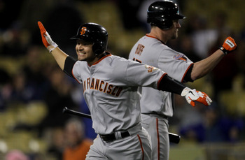 LOS ANGELES, CA - MAY 18:  Cody Ross #13 of the San Francisco Giants celebrates after hitting a three run home run in the ninth inning against the Los Angeles Dodgers on May 18, 2011 at Dodger Stadium in Los Angeles, California.  (Photo by Stephen Dunn/Ge