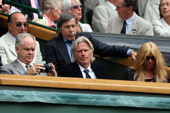 WIMBLEDON, ENGLAND - JULY 03:  Ilie Nastase (3R), Bjorn Borg (2R) and wife his Patricia (R) look on from Centre Court on Day Eleven of the Wimbledon Lawn Tennis Championships at the All England Lawn Tennis and Croquet Club on July 3, 2009 in London, Engla