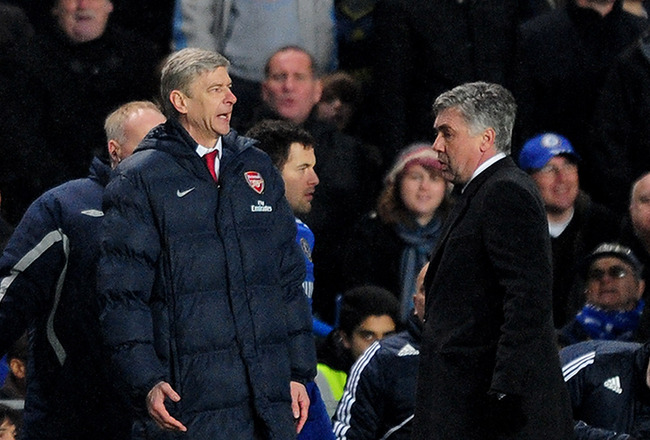 LONDON, ENGLAND - FEBRUARY 07:  Chelsea Manager Carlo Ancelotti (R) and Arsenal Manager Arsene Wenger speak during the Barclays Premier League match between Chelsea and Arsenal at Stamford Bridge on February 7, 2010 in London, England.  (Photo by Mike Hew