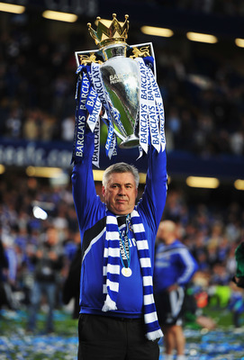 LONDON, ENGLAND - MAY 09:  Carlo Ancelotti manager of Chelsea celebrates with the trophy as they win the title after the Barclays Premier League match between Chelsea and Wigan Athletic at Stamford Bridge on May 9, 2010 in London, England. Chelsea won 8-0