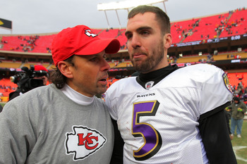 KANSAS CITY, MO - JANUARY 09:  Head coach Todd Haley of the Kansas City Chiefs and quarterback Joe Flacco #5 of the Baltimore Ravens speak to each other on the field after the Ravens defeated the Chiefs 30-7 in the 2011 AFC wild card playoff game at Arrow
