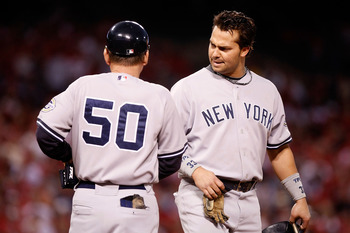 ANAHEIM, CA - OCTOBER 20:  Nick Swisher #33 (R) of the New York Yankees talks with first base coach Mick Kelleher in Game Four of the ALCS against the Los Angeles Angels of Anaheim during the 2009 MLB Playoffs at Angel Stadium on October 20, 2009 in Anahe