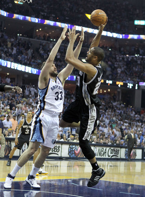 MEMPHIS, TN - APRIL 29:  Tim Duncan #21 of the San Antonio Spurs shoots the ball while defended by Marc Gasol #33 of the Memphis Grizzlies in Game Six of the Western Conference Quarterfinals in the 2011 NBA Playoffs at FedExForum on April 29, 2011 in Memp