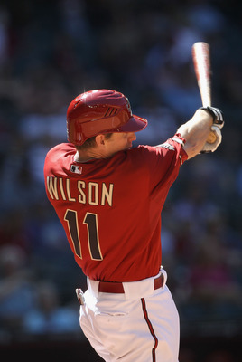 PHOENIX, AZ - APRIL 27:  Josh Wilson #11 of the Arizona Diamondbacks bats against the Philadelphia Phillies during the Major League Baseball game at Chase Field on April 27, 2011 in Phoenix, Arizona. The Phillies defeated the Diamondbacks 8-4.  (Photo by