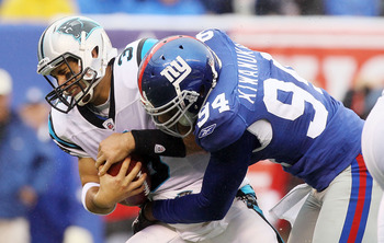 EAST RUTHERFORD, NJ - SEPTEMBER 12:  Matt Moore #3 of the Carolina Panthers is sacked in the fourth quarter by Mathias Kiwanuka #94 of the New York Giants on September 12, 2010 at the New Meadowlands Stadium in East Rutherford, New Jersey. The Giants defe