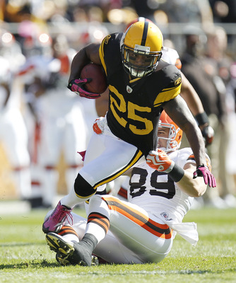 PITTSBURGH - OCTOBER 17:  Ryan Clark #25 of the Pittsburgh Steelers tries to escape the tackle of Evan Moore #89 of the Cleveland Browns after a first quarter interception on October 17, 2010 at Heinz Field in Pittsburgh, Pennsylvania.  (Photo by Gregory