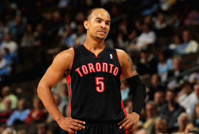 DENVER, CO - MARCH 21:  Jerryd Bayless #5 of the Toronto Raptors looks on during a break in the action against the Denver Nuggets at the Pepsi Center on March 21, 2011 in Denver, Colorado. The Nuggets defeated the Raptors 123-90. NOTE TO USER: User expres