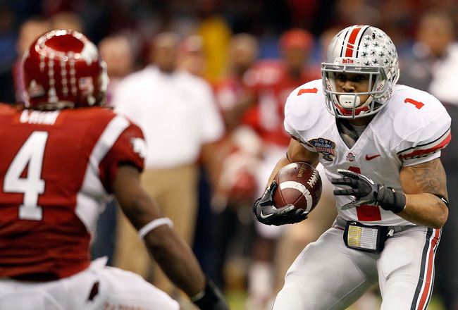 NEW ORLEANS, LA - JANUARY 04:  Dan Herron #1 of the Ohio State Buckeyes runs the ball against the Arkansas Razorbacks during the Allstate Sugar Bowl at the Louisiana Superdome on January 4, 2011 in New Orleans, Louisiana.  (Photo by Matthew Stockman/Getty