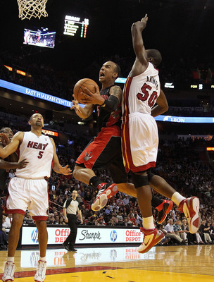MIAMI, FL - JANUARY 22:  Jerryd Bayless #5 of the Toronto Raptors goes up for a shot against Joel Anthony #50 of the Miami Heat during a game at American Airlines Arena on January 22, 2011 in Miami, Florida. NOTE TO USER: User expressly acknowledges and a