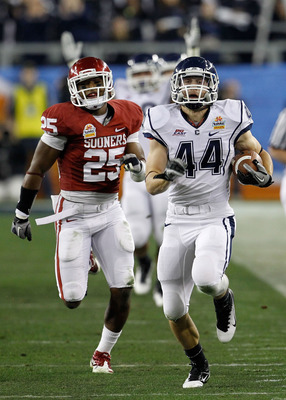 GLENDALE, AZ - JANUARY 01:  Robbie Frey #44 of the Connecticut Huskies score a 95-yard kick return for a touchdown in the third quarter against the Oklahoma Sooners in the Tostitos Fiesta Bowl at the Universtity of Phoenix Stadium on January 1, 2011 in Gl