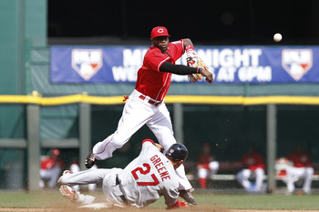 CINCINNATI, OH - MAY 14: Brandon Phillips #4 of the Cincinnati Reds turns a double play over Tyler Greene #27 of the St. Louis Cardinals at Great American Ball Park on May 14, 2011 in Cincinnati, Ohio. The Reds defeated the Cardinals 7-3. (Photo by Joe Ro