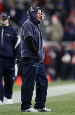FOXBORO, MA - JANUARY 16:  Head coach Bill Belichick of the New England Patriots stands on the field during their 2011 AFC divisional playoff game against the New York Jets at Gillette Stadium on January 16, 2011 in Foxboro, Massachusetts.  (Photo by Elsa