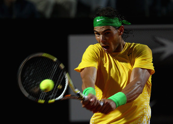 ROME, ITALY - MAY 15:  Rafael Nadal of Spain in action during the final against Novak Djokovic of Serbia during day eight of the Internazoinali BNL D'Italia at the Foro Italico Tennis Centre on May 15, 2011 in Rome, Italy.  (Photo by Clive Brunskill/Getty