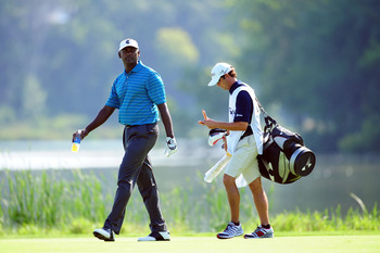 CHASKA, MN - AUGUST 14:  Vijay Singh of Fiji walks with his caddie Chad Reynolds on the 16th hole during the second round of the 91st PGA Championship at Hazeltine National Golf Club on August 14, 2009 in Chaska, Minnesota.  (Photo by Stuart Franklin/Gett