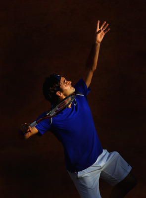 ROME, ITALY - MAY 12:  Roger Federer of Switzerland serves during his third round match against Richard Gasquet of France during day five of the Internazionali BNL d'Italia at the Foro Italico Tennis Centre on May 12, 2011 in Rome, Italy.  (Photo by Alex