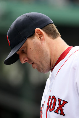 BOSTON, MA - MAY 05:  John Lackey #41 of the Boston Red Sox walks into the dugout after he was pulled from the game against the Los Angeles Angels on May 5, 2011 at Fenway Park in Boston, Massachusetts.  (Photo by Elsa/Getty Images)