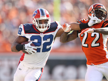 CINCINNATI - NOVEMBER 21:  Fred Jackson #22 of the Buffalo Bills runs with the ball while defended by Johnathan Joseph #22 of the Cincinnati Bengals during the NFL game at Paul Brown Stadium on November 21, 2010 in Cincinnati, Ohio. The Bills won 49-21.