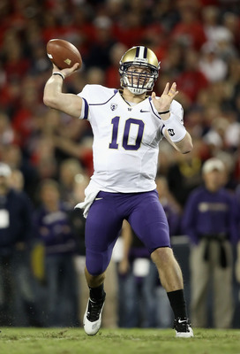 TUCSON, AZ - OCTOBER 23:  Quarterback Jake Locker #10 of the Washington Huskies throws a pass during the college football game against the Arizona Wildcats at Arizona Stadium on October 23, 2010 in Tucson, Arizona.  (Photo by Christian Petersen/Getty Imag