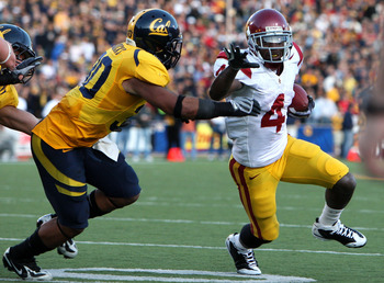 BERKELEY, CA - OCTOBER 03:  Joe McKnight #4 of the USC Trojans runs against Mychal Kendricks #30 of the California Golden Bears at Memorial Stadium on October 3, 2009 in Berkeley, California.  (Photo by Jed Jacobsohn/Getty Images)