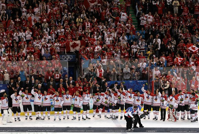 VANCOUVER, BC - FEBRUARY 28:  Team Canada acknowledge the fans after receiving their gold medals and the playing of the Canadian National Anthem in the ice hockey men's gold medal game between USA and Canada on day 17 of the Vancouver 2010 Winter Olympics