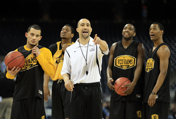 HOUSTON, TX - APRIL 01:  Head coach Shaka Smart of the Virginia Commonwealth Rams points as he stands next to Joey Rodriguez #12, Ed Nixon #50 and Darius Theus #10 during practice prior to the 2011 Final Four of the NCAA Division I Men's Basketball Tourna