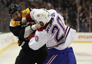 Montreal's James Wisniewski fights Boston's Shane Hnidy