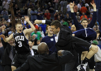 NEW ORLEANS, LA - MARCH 26:  Head coach Brad Stevens of the Butler Bulldogs celebrates with his team after they defeated the Florida Gators 74 to 71 in overtime during the Southeast regional final of the 2011 NCAA men's basketball tournament at New Orlean