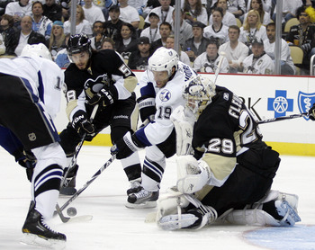 PITTSBURGH, PA - APRIL 23:  Dominic Moore #19 of the Tampa Bay Lightning battles for the puck with Kris Letang #58 as Marc-Andre Fleury #29 of the Pittsburgh Penguins protects the net in Game Five of the Eastern Conference Quarterfinals during the 2011 NH