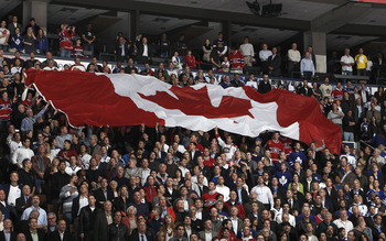 TORONTO, CANADA - OCTOBER 07: A giant Canadian flag is passed around during an opening night pre-game ceremony before a regular season NHL game between the Toronto Maple Leafs  and the Montreal Canadiens at the Air Canada Centre October 7, 2010 in Toronto