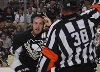 PITTSBURGH - OCTOBER 07: Brooks Orpik #44 of the Pittsburgh Penguins argues a penalty call by referee Francois St. Laurent #38 in his game against  the Philadelphia Flyers at the Consol Energy Center on October 7, 2010 in Pittsburgh, Pennsylvania.  (Photo