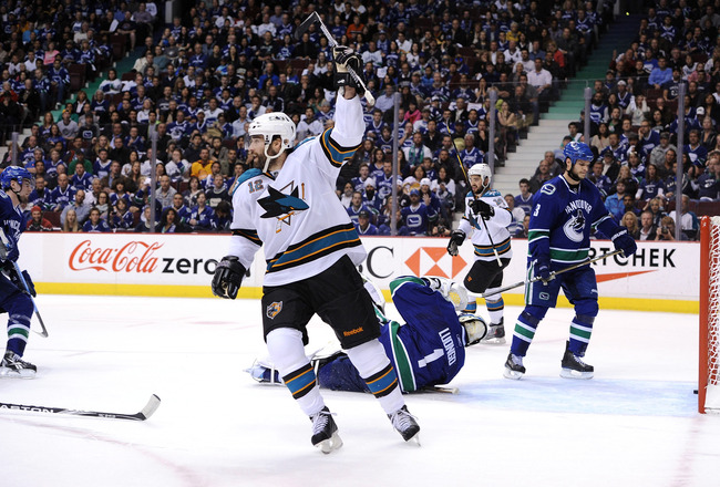 VANCOUVER, BC - MAY 15:  Patrick Marleau #12 and Devin Setoguchi #16 of the San Jose Sharks react after a goal by teammate Joe Thornton #19 (not in photo) as Kevin Bieksa #3 of the Vancouver Canucks looks on in the first period in Game One of the Western
