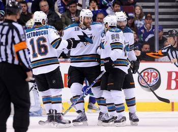 VANCOUVER, CANADA - MAY 15:  Devin Setoguchi #16, Joe Thornton #19 and Dan Boyle #22 of the San Jose Sharks congratulate teammate Patrick Marleau #12 after Marleau's goal against the Vancouver Canucks in the second period in Game One of the Western Confer