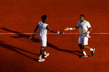 MONACO - APRIL 13:  Gael Monfils (L) of France with partner Jo-Wilfried Tsonga of France in their doubles match against Lukas Dlouhy of Czech Republic and Janko Tipsarevic of Serbia during Day Four of the ATP Masters Series Tennis at the Monte Carlo Count