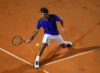 ROME, ITALY - MAY 11:  Roger Federer of Switzerland stretches for the ball during his second round match against Jo-Wilfried Tsonga of France during day four of the Internazionali BNL d'Italia at the Foro Italico Tennis Centreon May 11, 2011 in Rome, Ital