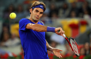 MADRID, SPAIN - MAY 07:  Roger Federer of Switzerland plays a backhand in his match against Rafael Nadal of Spain during day eight of the Mutua Madrilena Madrid Open Tennis on May 7, 2011 in Madrid, Spain.  (Photo by Julian Finney/Getty Images)