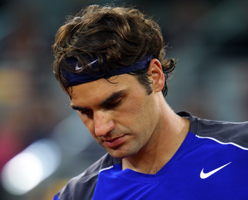 MADRID, SPAIN - MAY 07:  Roger Federer of Switzerland looks down in his match against Rafael Nadal of Spain during day eight of the Mutua Madrilena Madrid Open Tennis on May 7, 2011 in Madrid, Spain.  (Photo by Julian Finney/Getty Images)