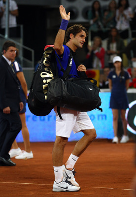 MADRID, SPAIN - MAY 07:  Roger Federer of Switzerland walks off court after losing Rafael Nadal of Spain during day eight of the Mutua Madrilena Madrid Open Tennis on May 7, 2011 in Madrid, Spain.  (Photo by Julian Finney/Getty Images)