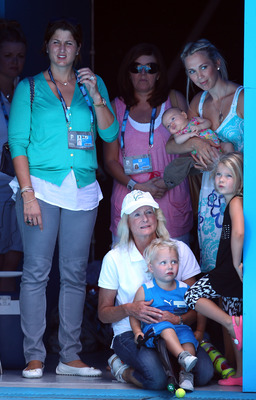MELBOURNE, AUSTRALIA - JANUARY 16:  Mirka Federer, Cherilyn Hewitt with Cruz, Bec Cartwright and Mia enjoy the tennis during the 'Rally For Relief' charity exhibition match ahead of the 2011 Australian Open at Melbourne Park on January 16, 2011 in Melbour