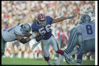 31 Jan 1993:  Linebacker Darryl Talley of the Buffalo Bills works against the Dallas Cowboys during Super Bowl XXVII at the Rose Bowl in Pasadena, California.  The Cowboys won the game, 52-17. Mandatory Credit: Rick Stewart  /Allsport
