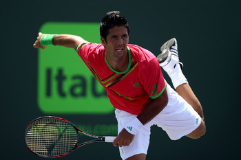 KEY BISCAYNE, FL - MARCH 25:  Fernando Verdasco of Spain serves against Pablo Andujar of Spain during the Sony Ericsson Open at Crandon Park Tennis Center on March 25, 2011 in Key Biscayne, Florida.  (Photo by Clive Brunskill/Getty Images)