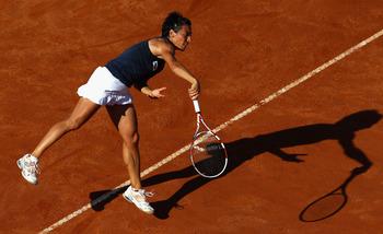 ROME, ITALY - MAY 13:  Francesca Schiavone of Italy serves during her quarter final match against Samantha Stosur of Australia  during day six of the Internazoinali BNL D'Italia at the Foro Italico Tennis Centre  on May 13, 2011 in Rome, Italy.  (Photo by