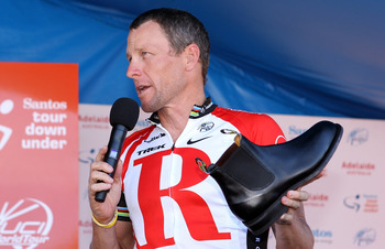 ADELAIDE, AUSTRALIA - JANUARY 23:  Lance Armstrong of the USA and Team Radio Shack holds a RM Williams shoe that is made locally in South Australia and was a presented to him as a gift by the Premier of South Australia, Mike Rann, after Stage Six of the 2