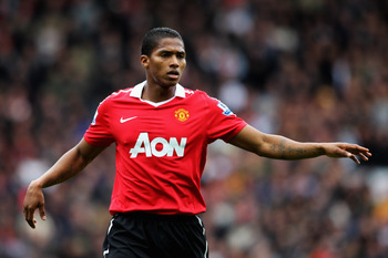 BLACKBURN, ENGLAND - MAY 14:  Antonio Valencia of Manchester United speaks to a team mate during the Barclays Premier League match between Blackburn Rovers and Manchester United at Ewood park on May 14, 2011 in Blackburn, England.  (Photo by Dean Mouhtaro
