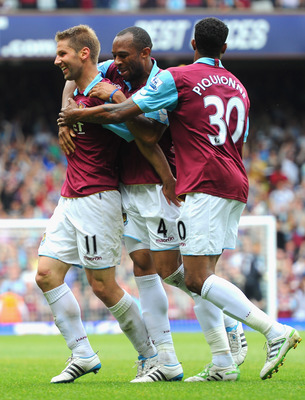 LONDON, ENGLAND - MAY 07:  Thomas Hitzlsperger of West Ham United (L) celebrates with team mates Danny Gabbidon and Frederic Piquionne after scoring the equalising goal during the Barclays Premier League match between West Ham United and Blackburn Rovers