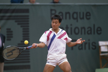 American tennis player Michael Chang at the French Open in Paris, 1989. He won the tournament, becoming the youngest male winner of a Grand Slam singles event at the age of 17. (Photo by Simon Bruty/Getty Images)