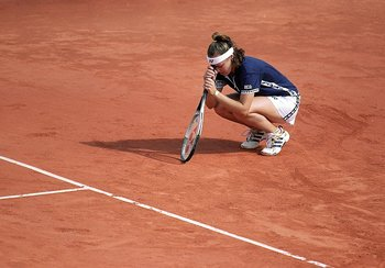 5 Jun 1999: Martina Hingis of Switzerland looks dejected as she leans her head on her racket after losing the second set in her women's final match to Steffi Graf of Germany in the women's singles final of the French Open at Roland Garros in Paris.